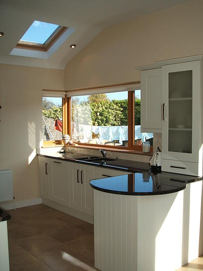 A simple yet effective ivory shaker kitchen installed in Kilkenny by Kitchen Makeover, Ireland