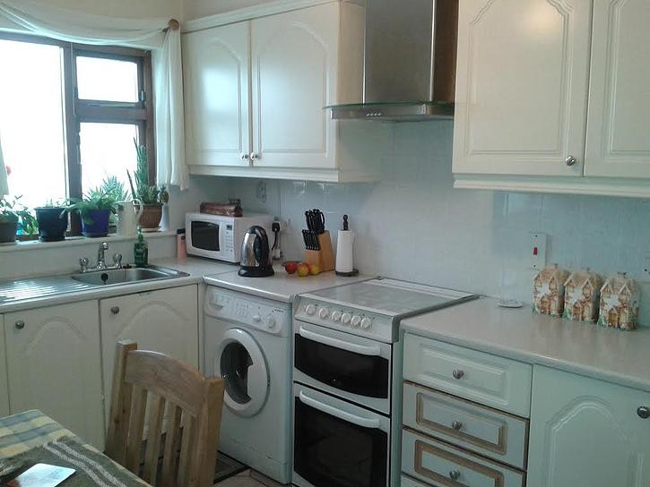 The pvc had peeled off some of the doors before the makeover of Mary's kitchen by  by Kitchen Makeover, Ireland