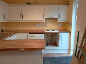 Sophie's kitchen afterrefurbishment by Kitchen Makeover, Ireland.  Ivory doors and walnut worktop are a classic combination